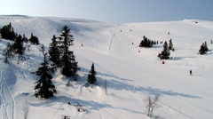 View to the slopes of the ski resort from the chair lift in Trysil, Norway. - stock footage