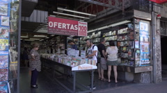 People in book shop on 18 July Avenue, Montevideo, Uruguay Stock Footage