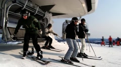 People exit from the ski chair lift at the ski resort in Trysil, Norway. Stock Footage