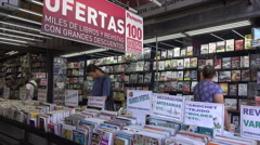 Customers in book shop on 18 July Avenue, Montevideo, Uruguay Stock Footage