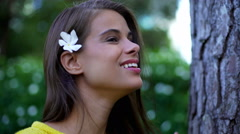 Female Hispanic making selfie video diary with flower - stock footage