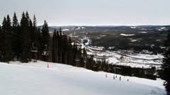 People move up with the ski chair lift at the ski resort in Trysil, Norway. Stock Footage