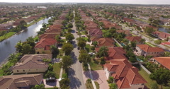 Aerial looking down on ANYWHERE USA suburban homes Stock Footage