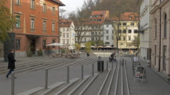 Man walking on a paved street in the old city center of Ljubljana Stock Footage