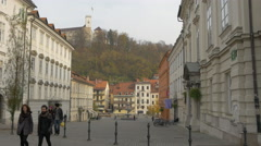 Two couples walking in the New Square in Ljubljana Stock Footage