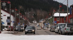 Cars pass by the street of Trysil, Norway. Stock Footage