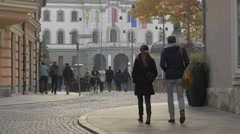 Couple walking on Wolfova street, close to the Congress Square in Ljubljana Stock Footage