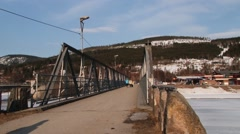 People pass by the bridge in in Trysil, Norway. Stock Footage