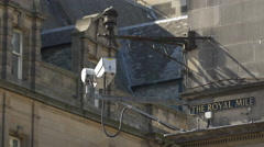 Surveillance camera on the corner of a building in Edinburgh, UK Stock Footage