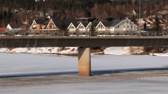 Cars pass by the bridge in in Trysil, Norway. Stock Footage