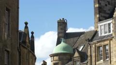 Tilt down view of Cockburn Street's buildings in Edinburgh, UK Stock Footage