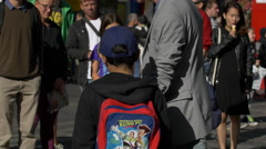 Boy with Toy Story backpack in Edinburgh, UK Stock Footage
