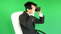 Businessman with VR glasses - 3D - green screen - stock footage