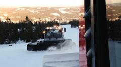 People drive snowcat machine preparing ski slope in Trysil, Norway. Stock Footage