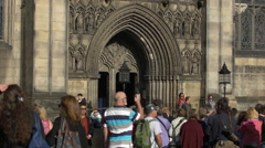 Tourists in front of St Giles' Cathedral in Edinburgh, UK Stock Footage