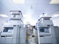 Stock Photo of Scientists in laboratory with analytical scientific equipment