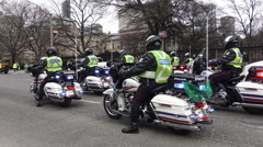 Toronto police on motorcycles at the 29th Annual Saint Patrick's Parade 2016 Stock Footage