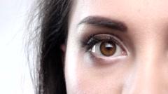 Beautiful hazel eye blinkin. Close up. Slow motion - stock footage