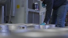 4K Worker in a brewery preparing barrels of beer for distribution - stock footage