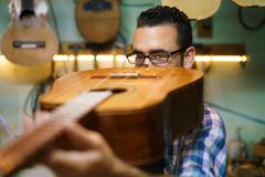 Lute Maker Checking Bridge And Arm Of Classic Guitar Stock Photos