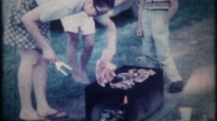 1198 mom barbecues, children play, summer picnic - vintage film home movie Stock Footage
