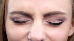 Woman's eye, squint. Close up. Slow motion Stock Footage