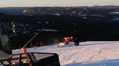 People drive snowcat machines preparing ski slopes in Trysil, Norway. Stock Footage
