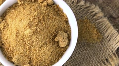 Portion of brown Coconut Sugar (not loopable; 4K) Stock Footage