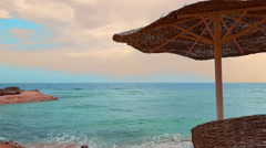 Parasols beach umbrellas on the tropical beach at sunny summer day Stock Footage