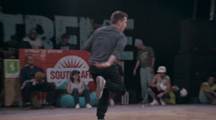 Young Man Dancer Making Brake Dancing Movements on a Dancing Stock Footage