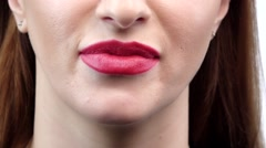 Beautiful smiling young woman with perfect skin, red lipstick and teeth. Close - stock footage