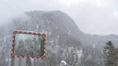 View of trees reflecting on a traffic mirror on a winter day, Hallstatt Stock Footage
