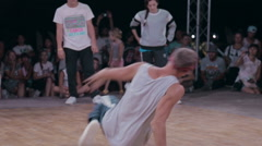 Young Dancer in White T-Shirt Performing the Elements of Break Dance on the Stock Footage