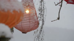 Close view of lanterns hanging on a tree on a winter day, Hallstatt Stock Footage