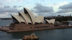 Sydney Opera house with boats passing by Stock Footage