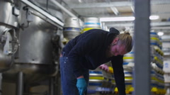 4K Worker in a brewery preparing barrels of beer for distribution Stock Footage