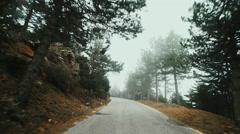 Pov drive mountain winter road foggy overcast gimbal Stock Footage