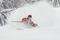 Cross country skier on snowy terrain Stock Photos