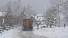 Shoveling snow machine driving on a street, Hallstatt Stock Footage