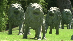 A pack of lions roaring statues Stock Footage