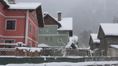 Stock Video Footage of A pink and a green house on a winter day, Hallstatt