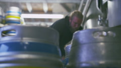 4K Worker in a brewery preparing barrels of beer - stock footage