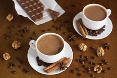Coffee and chocolate on wood - stock photo
