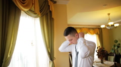 Young successful bussinessman dressing white shirt prepare for a bussiness Stock Footage
