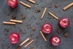 Red apples, star anise and cinnamon Stock Photos