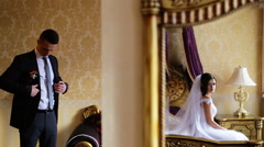 Young full of emotions bride waiting until his future husbund get ready for a Stock Footage