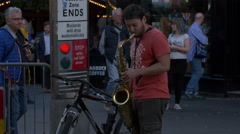 Man playing a saxophone in Edinburgh, UK Stock Footage