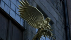 Close view of a golden statue of an eagle in Edinburgh, UK - stock footage