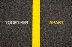 Antonym concept of TOGETHER versus APART Stock Photos