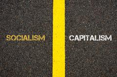 Antonym concept of SOCIALISM versus CAPITALISM - stock photo